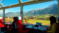 woman reading on passenger train in the Swiss Alps