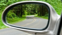 Road in rear view mirror