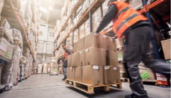 Motion blur of two men moving boxes in a warehouse picture id547406694