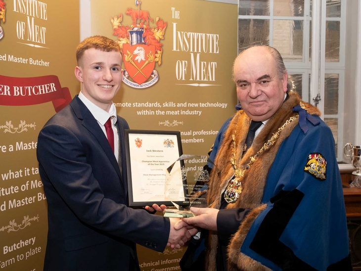Champion Meat Apprentice of the Year, Jack Western is presented his award by The Master, Tim Dumenil at the IOM / WCB Awards.