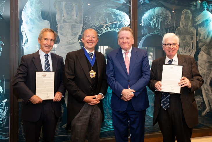 Gerald Shortland (far left) and Bob Bansback (far right) receiving their Gold Badge, pictured with The Master, Andrew Parker and guest speaker, Ian Wright of the Food & Drink Federation.