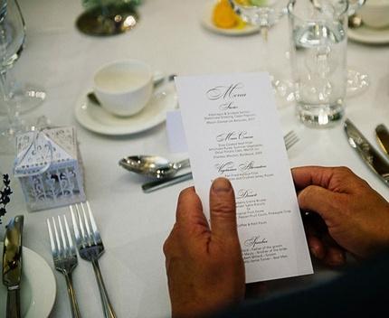 Butchers' Hall - wedding menu and table set up