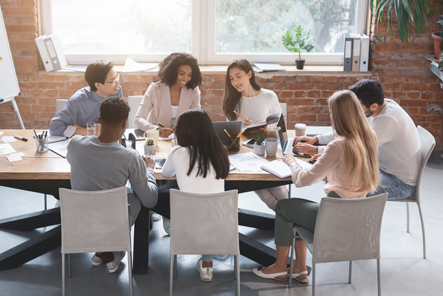 team of coworkers in a conference room for a meeting