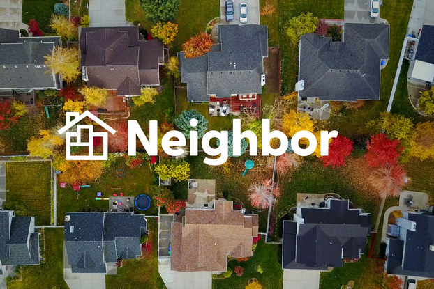image of a residential neighborhood from the top promoting Neighbor self-storage
