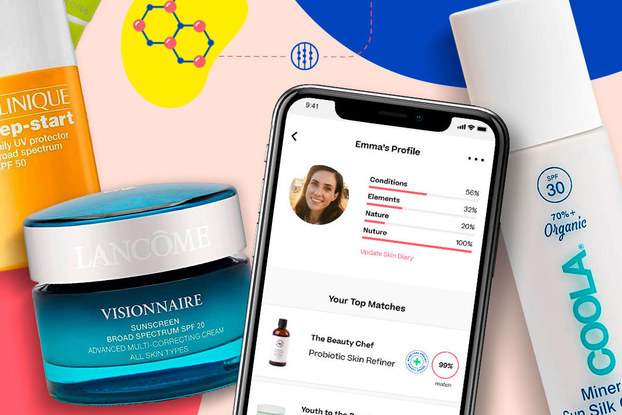 image of good face project's digital tool on a phone screen surrounded by beauty products