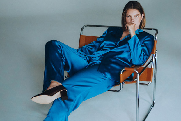 woman modeling a luxury suit from plus-size luxury fashion line, Henning.