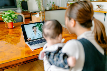 Telemedicine with doctor, mother and baby