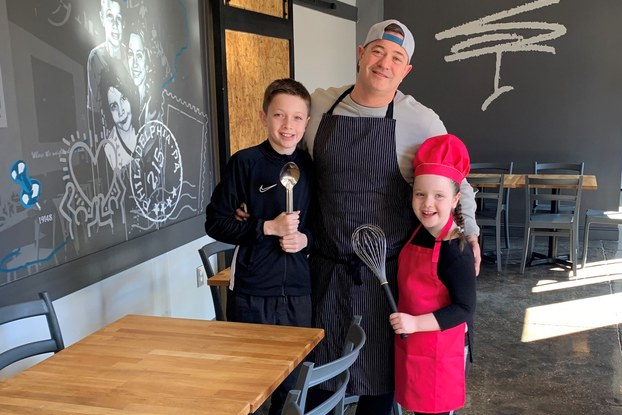Miles Table restaurant owner and his children inside the restaurant.