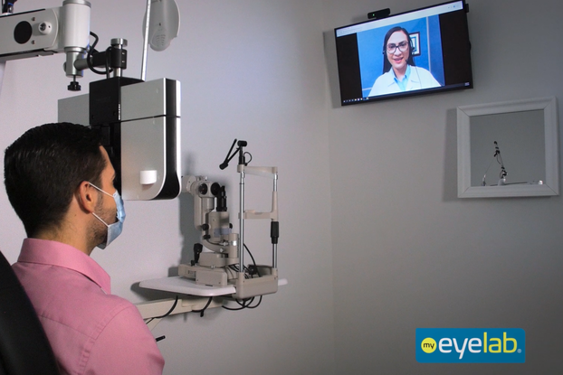 patient inside an eyelab location visiting virtually with a doctor for an eyeglass prescription.