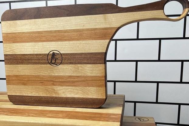 display of wood cutting boards created by Eddie Thomason.