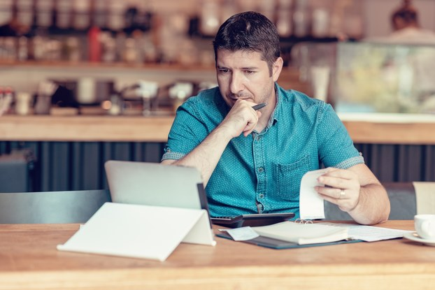 Business owner works on financials