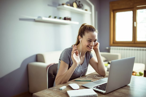 woman at home working remotely on laptop