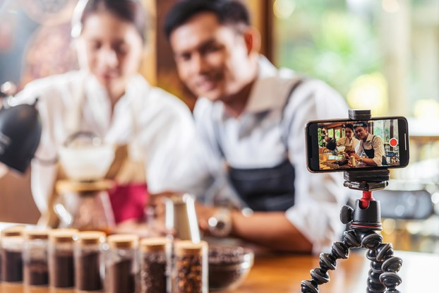 two people recording themselves on video