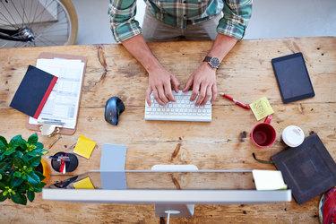 Entrepreneur works at his desk