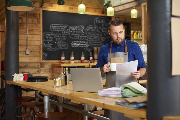 Entrepreneur checks his accounts