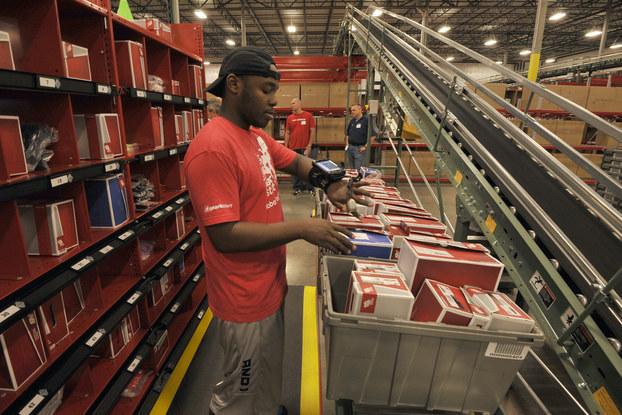 employee working in New Balance e-commerce warehouse.