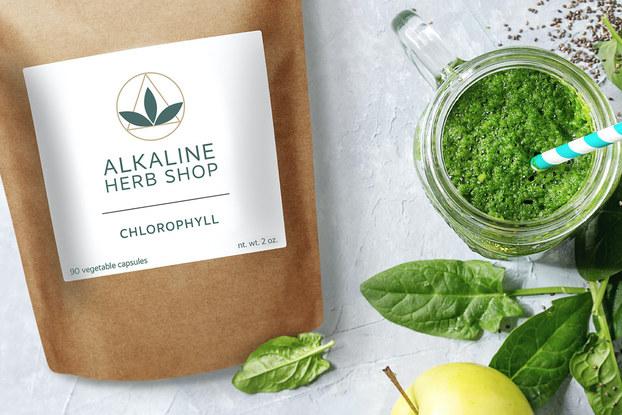 Bag of Alkaline Herb Shop herbs displayed with leaves and greens.
