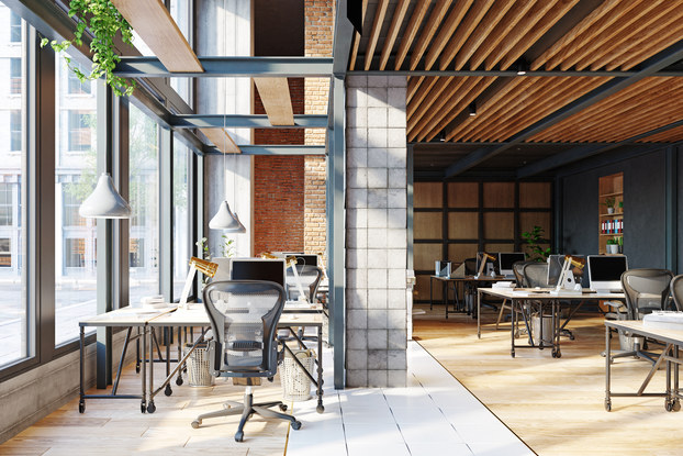Open office space with big windows and lots of light.