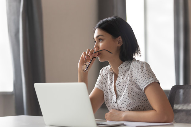 Woman considers options of a business decision