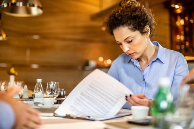 Woman entrepreneur reviews paperwork