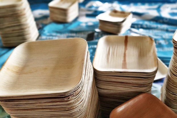 Display of Karmic Seed tableware stacked on a table.