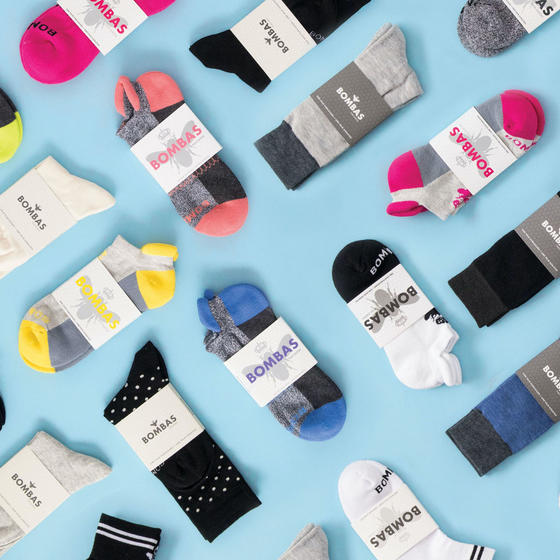 Bombas socks all spread out on a light blue background.