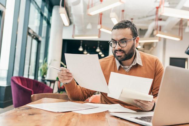 Businessman reviews financial documents