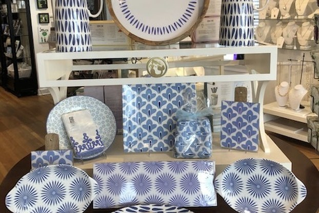 Display of blue and white housewares on sale at Splurge.