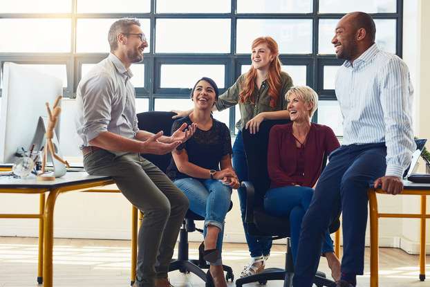 Business owner holds casual meeting with employees