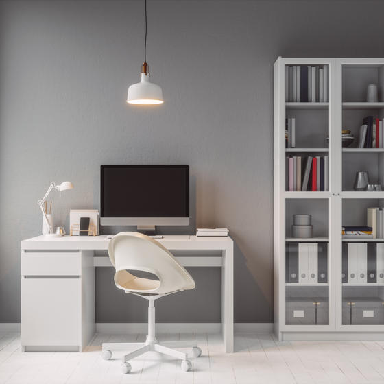 Modern home office with white furniture.
