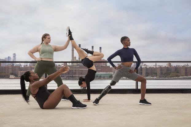 Models posing while wearing Thinx activewear.