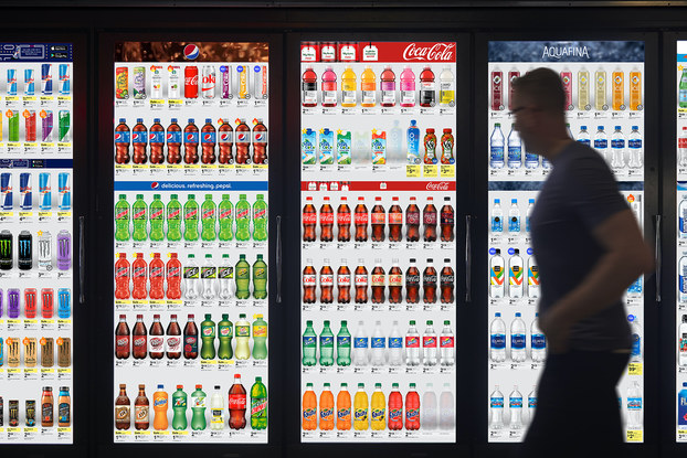 Cooler Screens on refrigerated product doors in Walgreens.
