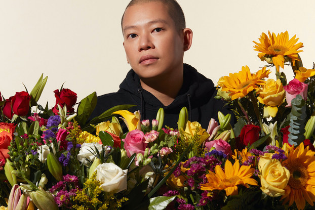 Fashion designer Jason Wu posing with flowers from 1-800-Flowers.