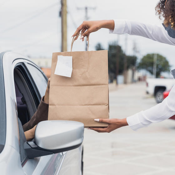A customer picks up a purchase using curbside pickup.