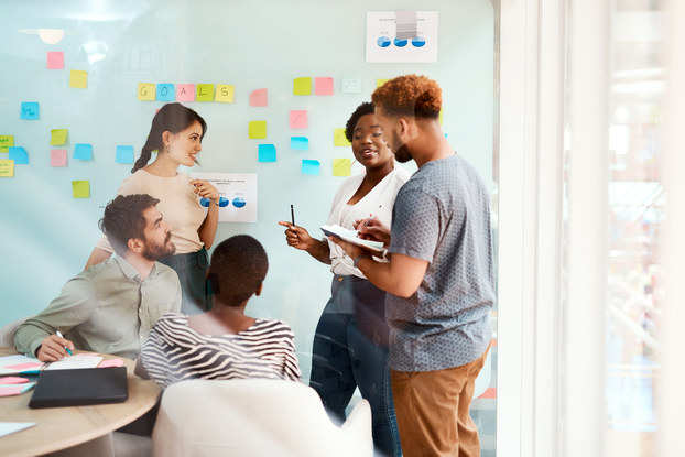 Group of young businesspeople collaborate in an office meeting