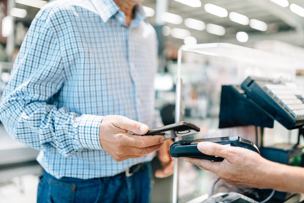 Customer pays for a purchase using contactless payment at POS