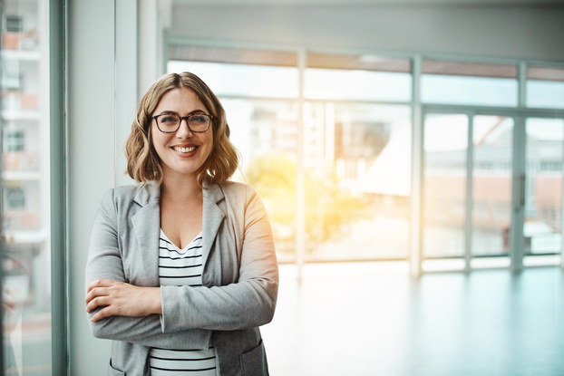 Portrait of a confident businesswoman in front of an office