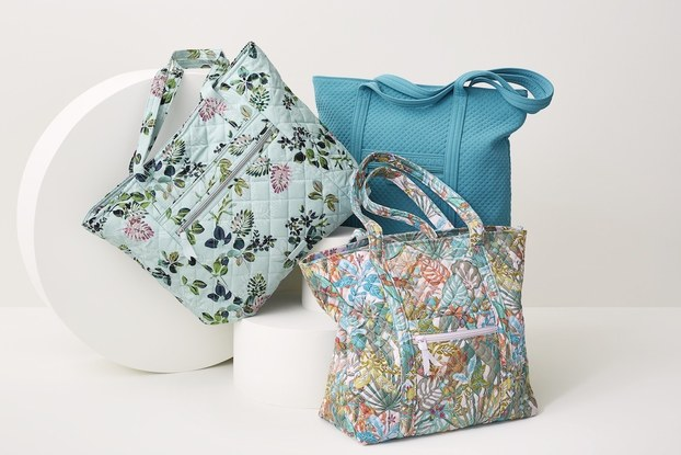 Product display of floral bags by Vera Bradley.