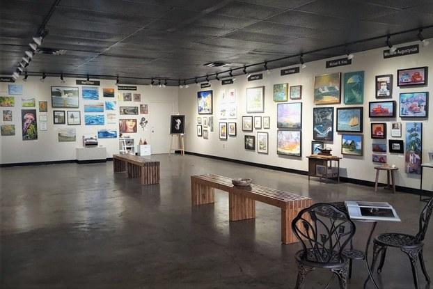 Art gallery with spotlights highlighting art