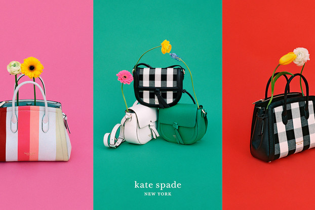 Colorful Kate Spade New York product display with pocketbooks and flowers.