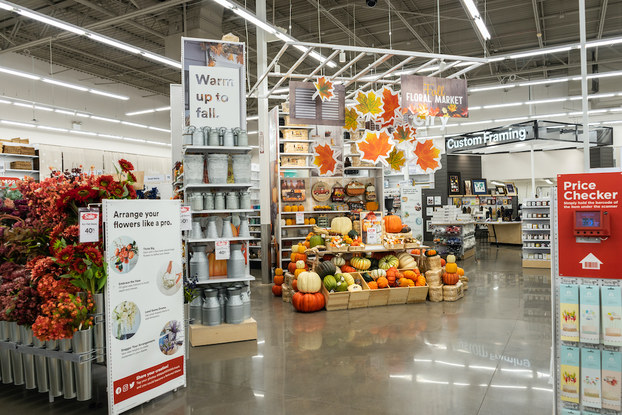 Interior of Michaels showing a fall-themed floral and decor display.