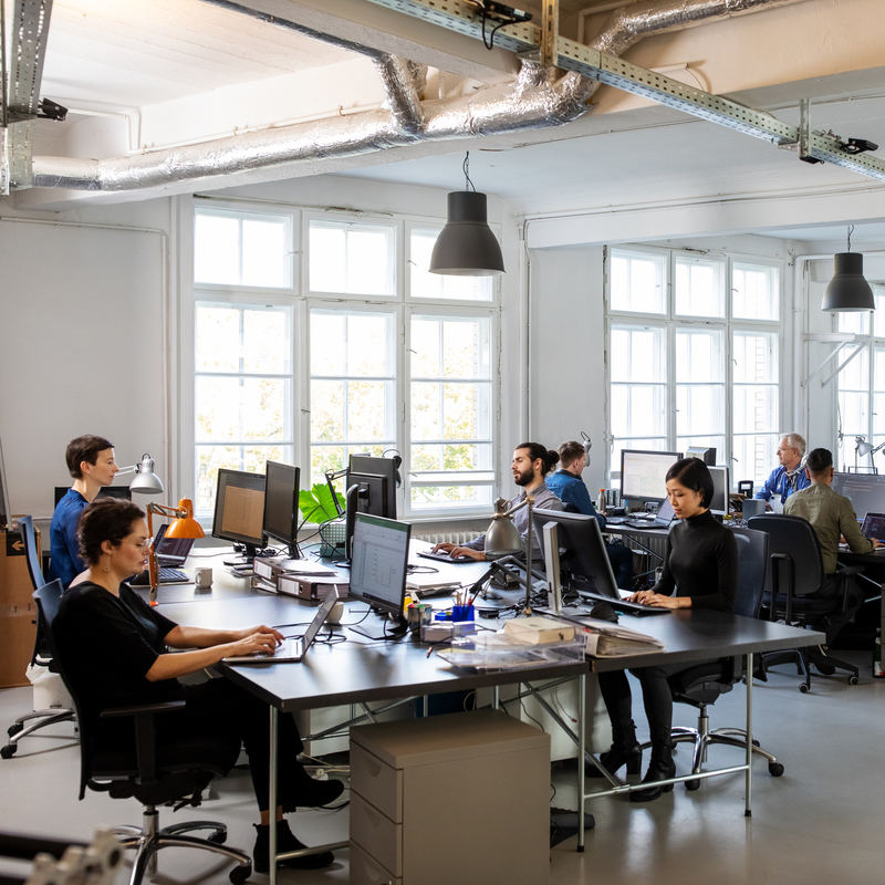 Busy modern open plan office with staff.