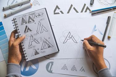 Overhead view of artist developing a logo design