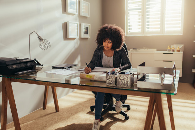 Woman working at desk in home office.