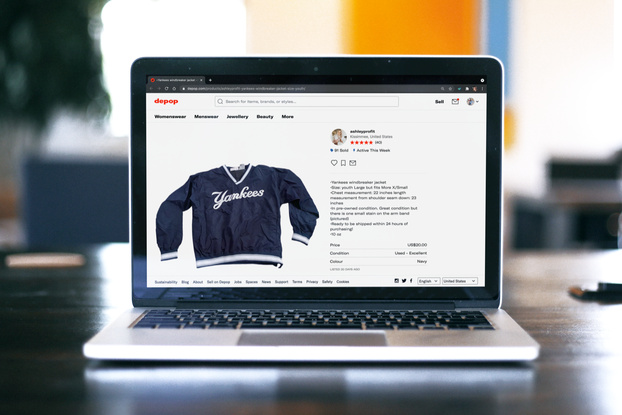 Laptop on table with the screen open to List Perfectly's site, where there is a Yankee's jacket for sale on Depop.