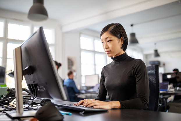 Woman uses computer in a modern office