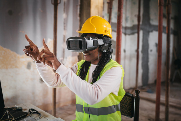 Woman uses augmented reality virtual or reality technology on worksite