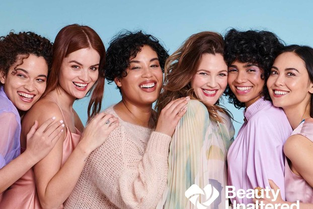 Models posing and smiling for the Beauty Unaltered campaign.