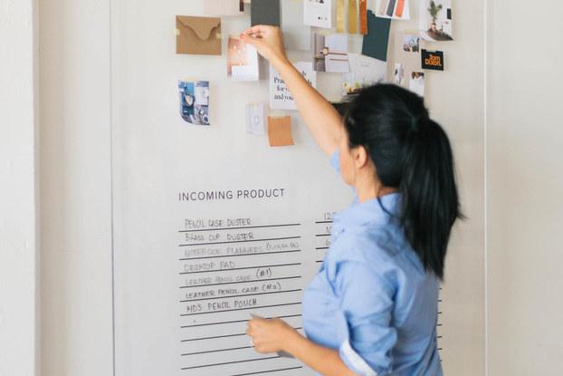 Woman looks at bulletin board