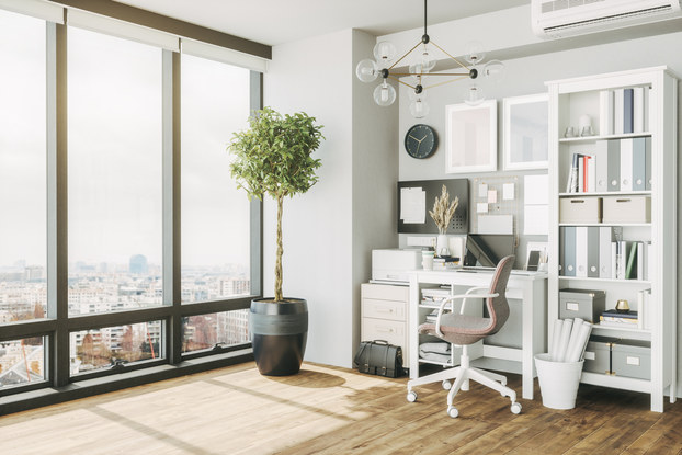 Home office in an apartment with floor-to-ceiling windows.